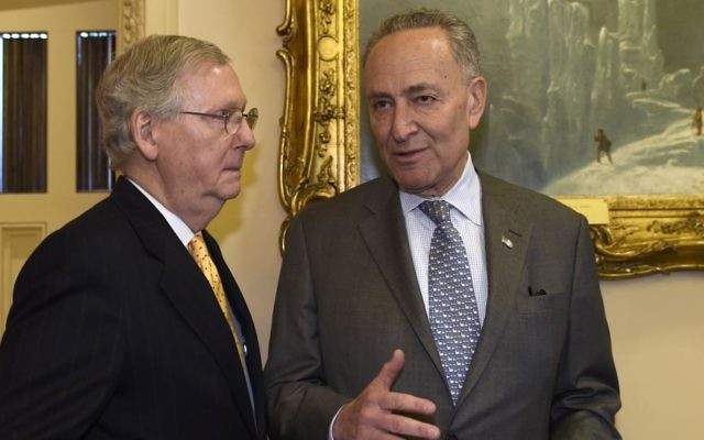 Senate Majority Leader Mitch McConnell of Ky., left, talks with Sen. Charles Schumer, D-N.Y., on Capitol Hill in Washington, Wednesday, April 13, 2016. (AP Photo/Susan Walsh)