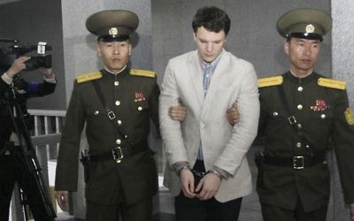 Otto Warmbier, center, is escorted at the Supreme Court in Pyongyang, North Korea, March 16, 2016.  (AP Photo/Jon Chol Jin)