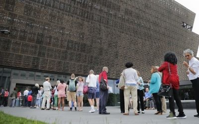 In this May 1, 2017, file photo, people wait in line to enter the Smithsonian National Museum of African American History and Cultural on the National Mall in Washington.  (AP/Pablo Martinez Monsivais, File)