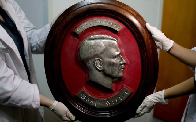 Members of the federal police show a bust relief portrait of Nazi leader Adolf Hitler at the Interpol headquarters in Buenos Aires, Argentina, June 16, 2017. (AP/Natacha Pisarenko)