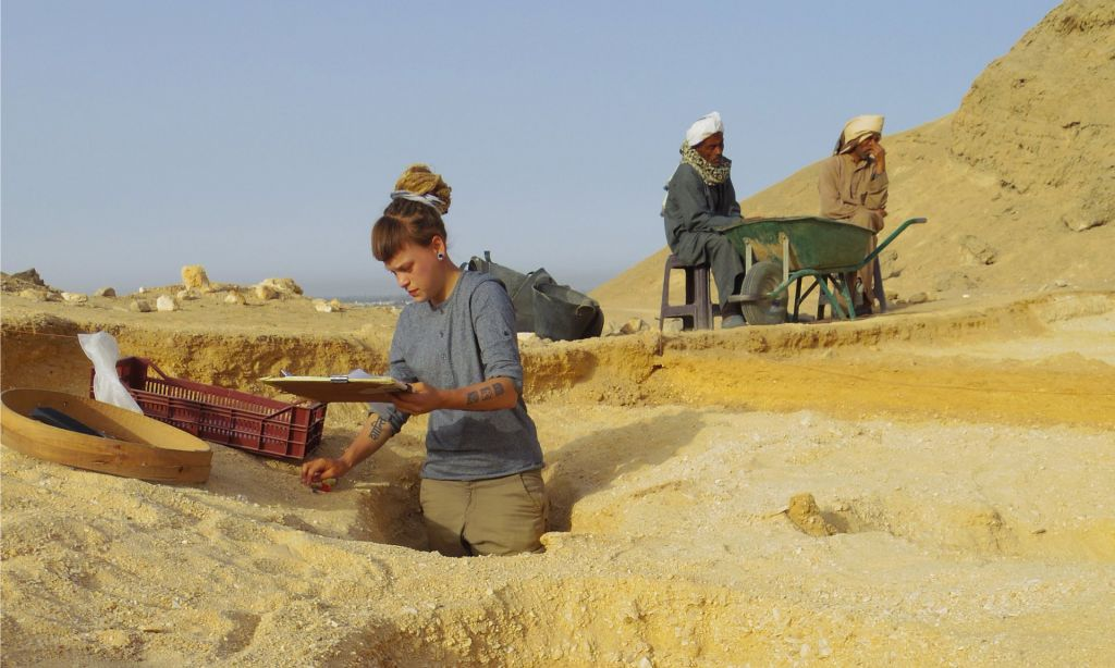 A field archaeologist excavates graves at the North Tombs Cemetery of Egypt's Amarna site. (Mary Shepperson/Courtesy of The Amarna Project)