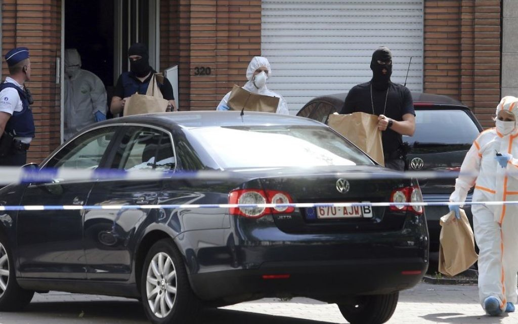 Police and forensic officers remove items during a house search in the Molenbeek district of Brussels on Wednesday, June 21, 2017. (AP Photo/Francois Walschaerts)