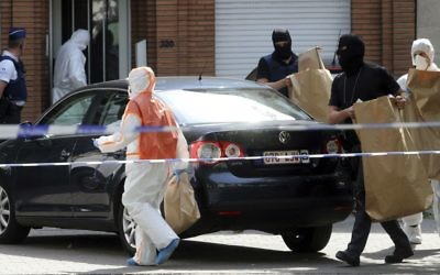 Police and forensic officers at a house search in the Molenbeek district of Brussels on Wednesday, June 21, 2017. (AP Photo/Francois Walschaerts)