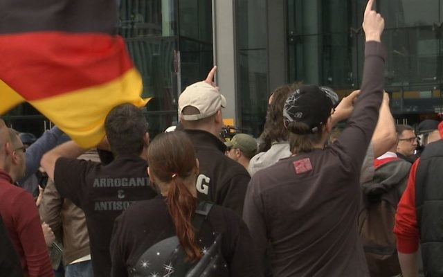 Demonstrators from the 'Third Position' political movement in Berlin. Screenshot from the documentary 'Chosen and Excluded -- Jew Hatred in Europe.' (Courtesy)