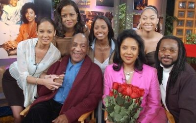In this Thursday, May 2, 2002 file photo, members of Bill Cosby's television family, the Huxtables, gather in NBC's Today show studio for an interview with co-host Katie Couric, in New York. From left are Sabrina Le Beauf, Tempest Bledsoe, Cosby, Keshia Knight Pulliam, Phylicia Rashad, Raven Symone and Malcolm-Jamal Warner. (AP Photo/Richard Drew)