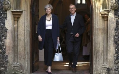 Britain's Prime Minister Theresa May and her husband Philip leave after attending Holy Communion at St Andrew's Church in Sonning, Berkshire, England, Sunday, June 11, 2017. (Jonathan Brady/PA Wire(/PA via AP)