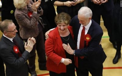 Britain's Labour Party leader Jeremy Corbyn, right, tries to high-five with Labour's Emily Thornberry after arriving for the declaration at his constituency in London, Friday, June 9, 2017.  (AP Photo/Frank Augstein)