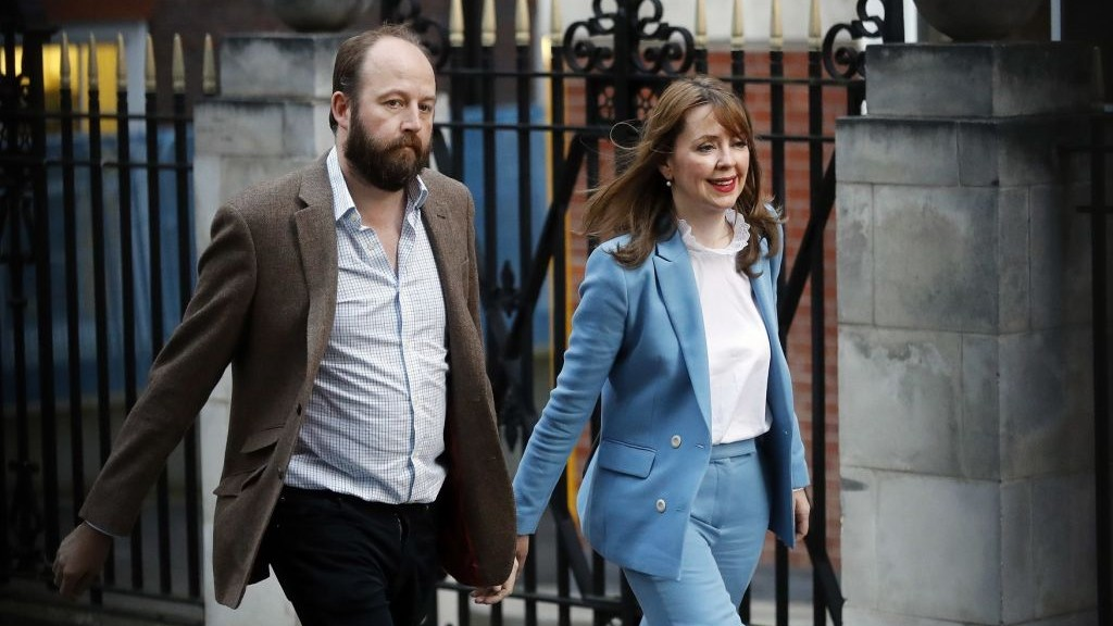 British Prime Minister Theresa May's chief of staff Nick Timothy and joint-chief of staff Fiona Hill leave Conservative Party headquarters in London, Friday, June 9, 2017. (AP Photo/Frank Augstein)