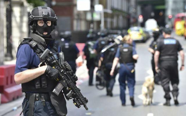 Armed police on St. Thomas Street, London, on June 4, 2017, near the scene of a terror attack on London Bridge and at the capital's Borough Market. (Dominic Lipinski/PA via AP)