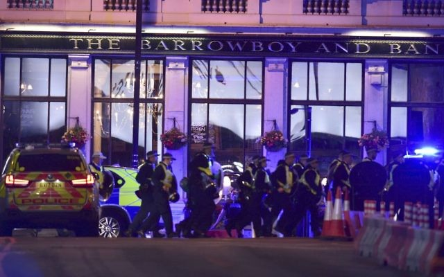 Police officers on Borough High Street during at least one an incident on London Bridge in London, June 3, 2017. (Dominic Lipinski/PA via AP)