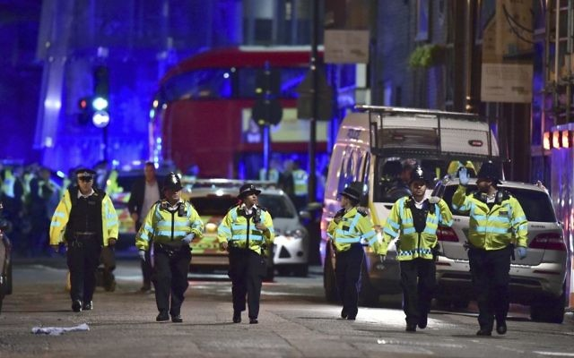 Police officers on Borough High Street during a terror attack on London Bridge in London, June 3, 2017. (Dominic Lipinski/PA via AP)