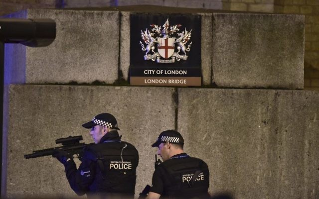 An armed police officer looks through his weapon on London Bridge in London, June 3, 2017. (Dominic Lipinski/PA via AP)