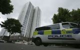 A police van drives past the Chalcots Estate in the borough of Camden, north London, June 25, 2017. (AP Photo/Tim Ireland)