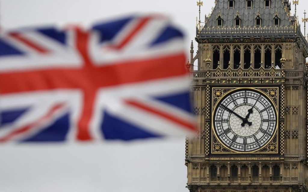 In this file photo dated Wednesday, March 29, 2017, a British flag is shown near to Big Ben's clock tower in front of the Houses of Parliament in central London. (AP Photo/Matt Dunham, FILE)
