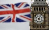 A British flag is shown near Big Ben's clock tower in front of the Houses of Parliament in central London, March 29, 2017. (AP Photo/Matt Dunham)