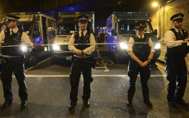 Police officers man a cordon at Finsbury Park where a vehicle struck pedestrians in London Monday, June 19, 2017. (Victoria Jones/PA via AP)