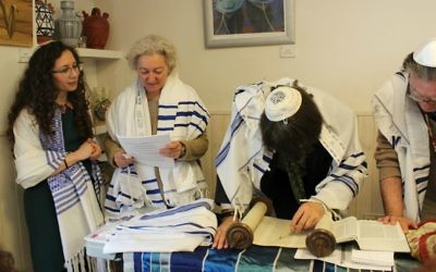 From left, Yael Cobano, Ruth Timon, Rabbi Stephen Berkowitz and Zohar Ben-David participating in the Torah reading at the Reform Jewish Community of Madrid. (Margarita Gokun Silver/via JTA)
