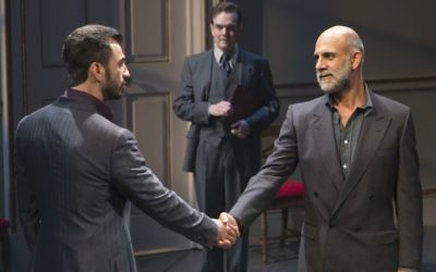 Michael Aronov and Anthony Azizi shake hands,  Jefferson Mays in the background in 'OSLO.' (Courtesy/T. Charles Erickson)