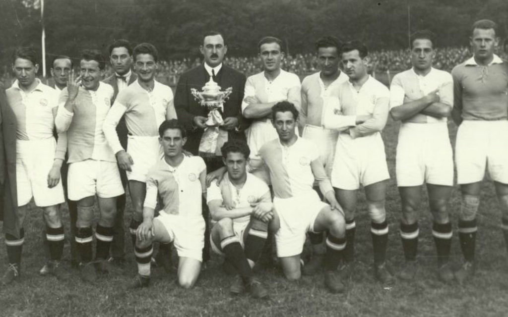 Bela Guttmann, to the right of the man in the suit, and the Hakoah Vienna football club with a trophy. (Courtesy)
