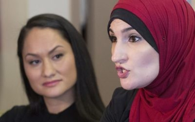 In this Jan. 9, 2017 file photo Linda Sarsour, right, and Carmen Perez, co-chairs of the Women's March on Washington, speak during an interview in New York. (AP Photo/Mark Lennihan, File)