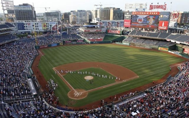 A photo of House Majority Whip Steve Scalise, R-La., is seen on the video board as the last member of the Republican team announced before the Congressional baseball game, Thursday, June 15, 2017, in Washington. The annual GOP-Democrats baseball game raises money for charity. (AP Photo/Alex Brandon)