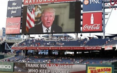 A message from President Donald Trump is shown on the video board before the Congressional baseball game, Thursday, June 15, 2017, in Washington. The annual GOP-Democrats baseball game raises money for charity. (AP Photo/Alex Brandon)