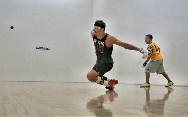 Handball star David Fink dives for a ball. (Courtesy)