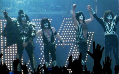Gene Simmons (r) with the band KISS seen making the two-fingered gesture at LG Arena in Birmingham, UK on May 10, 2010. (CC BY-SA Andrew King, Flickr)