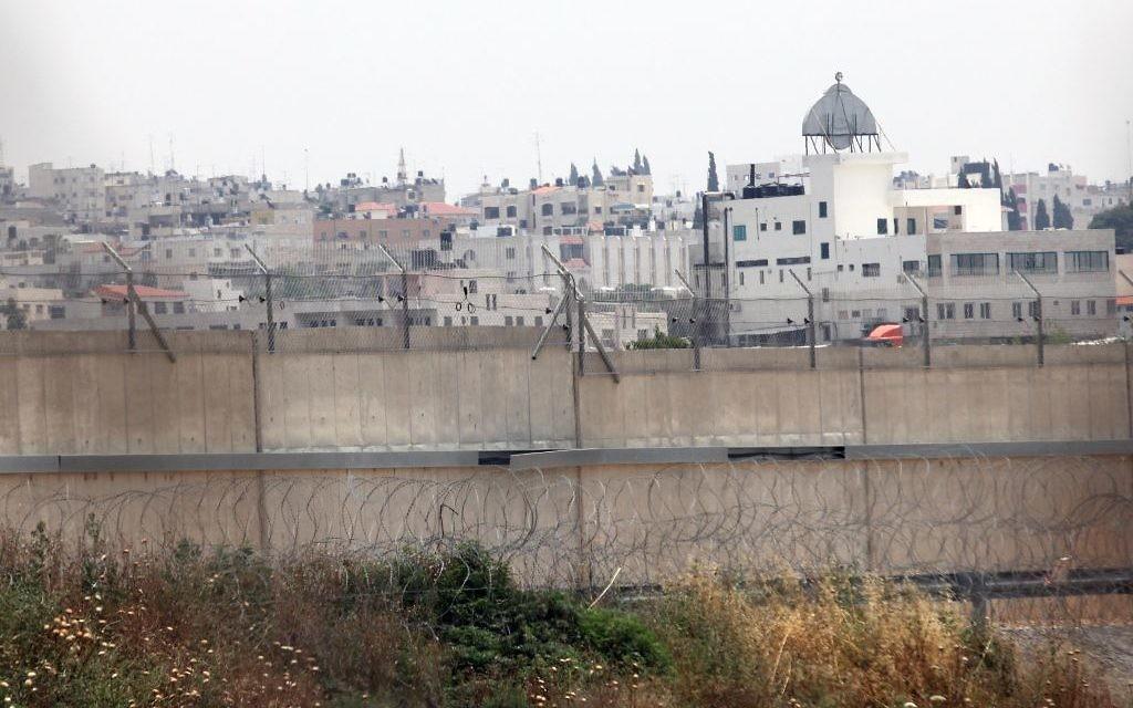 The West Bank town of Qalqilya is seen behind Israel's security barrier. (Yossi Zamir/Flash90)