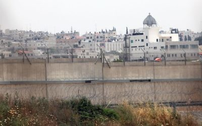 The West Bank town of Qalqilya is seen behind Israel's security barrier. (Yossi Zamir/Flash90)