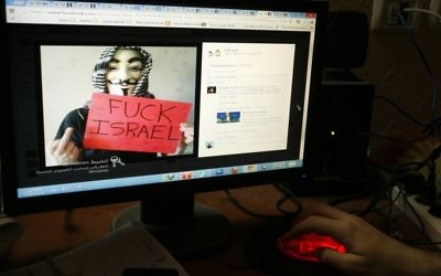 Illustrative photo of a Palestinian man looking at an anti-Israel Facebook page. April 07, 2013. (Abed Rahim Khatib/Flash90)