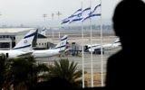 A passenger observes the runway from a window at Israel's Ben Gurion International Airport near Tel Aviv, April 21, 2013. (Flash90)