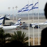 A passenger observes the runway from a window at Israel's Ben Gurion International Airport near Tel Aviv, April 21, 2013. (Flash90)