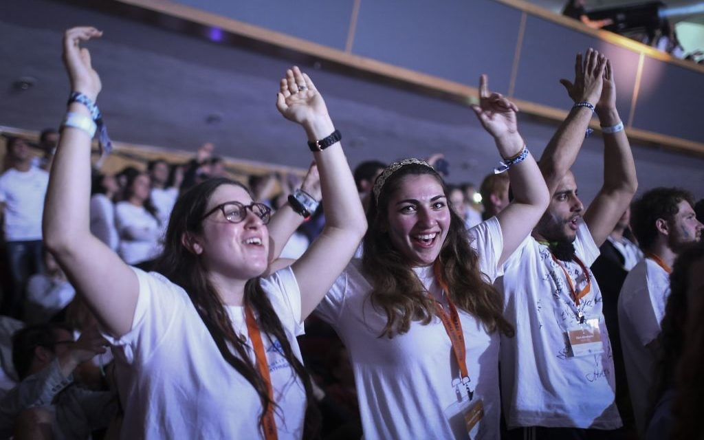 Participants in a Taglit Birthright program celebrate  at an event held at the International Conference Center in Jerusalem on January 14, 2015. (Hadas Parush/Flash90)