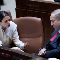 Prime Minister Benjamin Netanyahu, right, speaks with then-justice minister Ayelet Shaked in the Knesset, December 21, 2016. (Yonatan Sindel/Flash90)