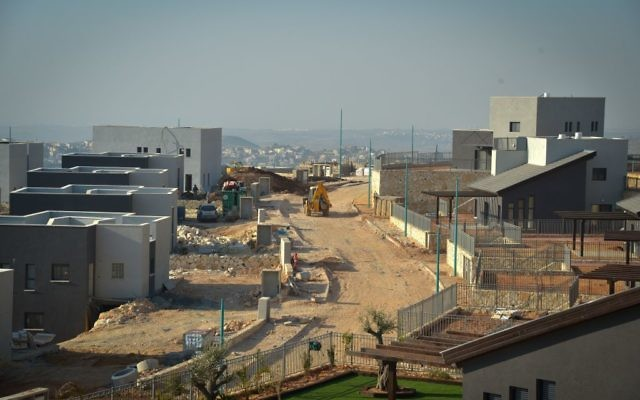 Construction of new buildings in the West Bank settlement of Na'ale on February 8, 2017. (Flash90)