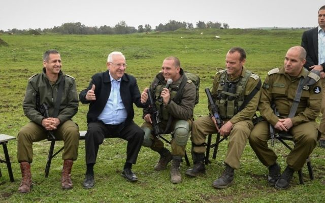President Reuven Rivlin visits during a drill by the Golani Battalion, on the Golan Heights, on February 22, 2017. (Mark Neyman/GPO)
