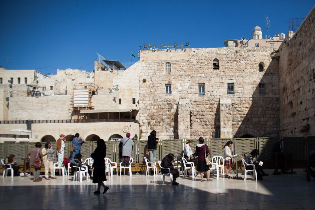 Jewish women pray at the Western Wall, Judaism's holiest prayer site in the Old City of Jerusalem, March 7, 2017. (Nora Savosnick/Flash90)
