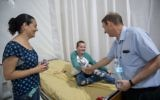 Prof. Michael Weintraub, former head of Hadassah Hospital's pediatric hemato-oncology department, speaks with a young patient at the protest tent in Sacher Park, Jerusalem, June 4, 2017. (Yonatan Sindel/Flash90)