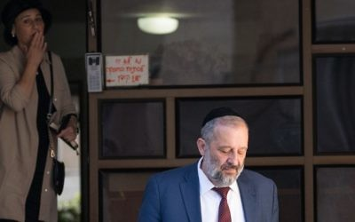 Aryeh Deri and his wife Yaffa seen leaving their home in Jerusalem, on June 5, 2017, as they make their way to questioning at the Lahav 433 anti-corruption unit. (Yonatan Sindel/Flash90)