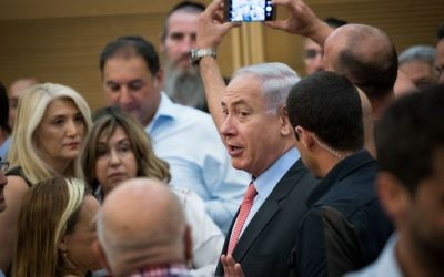 Prime Minister Benjamin Netanyahu arrives to a Likud party meeting at the Knesset on June 12, 2017. (Yonatan Sindel/Flash90)