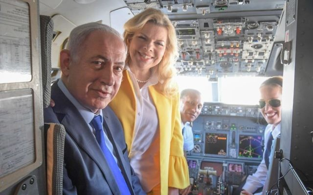 Prime Minister Benjamin Netanyahu and his wife, Sara, pose for a photo with pilot Nechama Spiegel Novak (right) before taking off from Ben Gurion International Airport to Greece, June 14, 2017. (Amos Ben Gershom/GPO)