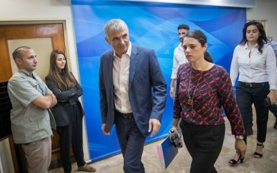 Finance Minister Moshe Kahlon and Justice Minister Ayelet Shaked arrive for the weekly cabinet meeting at the Prime Minister's Office in Jerusalem on June 18, 2017. (Yonatan Sindel/Flash90)