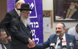 Shas party leader Interior Minister Aryeh Deri (R) United Torah Judaism party Mk Yaakov Litzman during a joint party meeting at the Knesset on June 19, 2017. (Yonatan Sindel/Flash90)