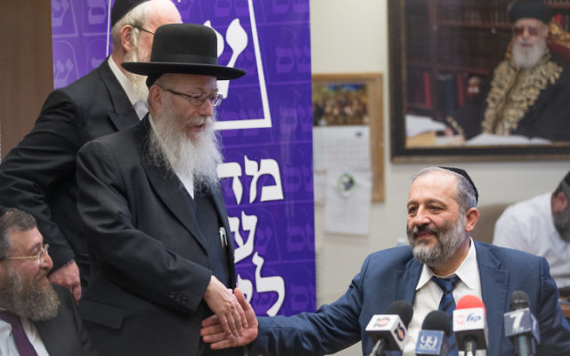 Shas party leader Aryeh Deri (R) United Torah Judaism party Mk Yaakov Litzman during a joint party meeting at the Knesset on June 19, 2017. (Yonatan Sindel/Flash90)