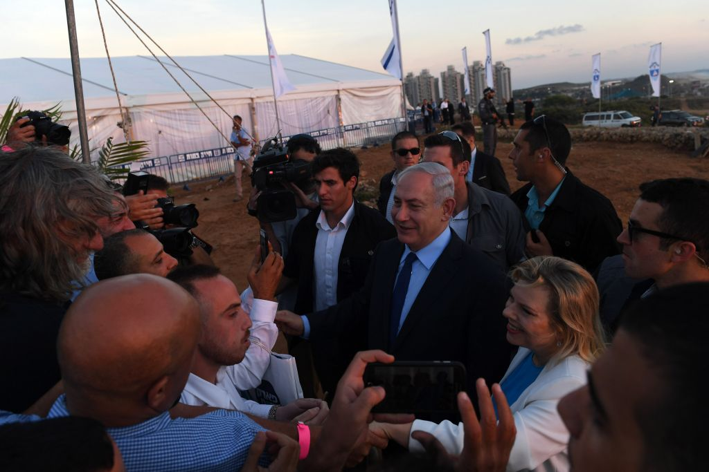Israeli prime minister Benjamin Netanyahu and his wife Sara at the cornerstone laying ceremony for a new park in Bat Yam, built in the name of late Yoni Netanyahu. June 22, 2017. (Kobi Gideon / GPO)