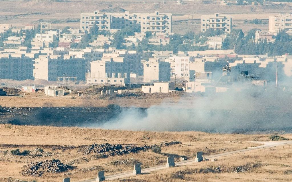 A picture taken from the Israeli side of the border shows smoke rising near the Israeli-Syrian border on June 24, 2017. (Basel Awidat/Flash90)