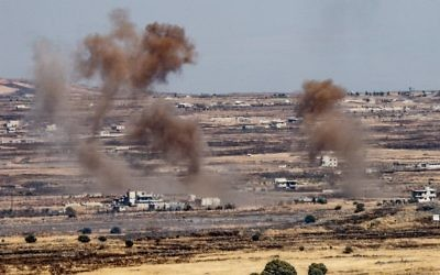 A picture taken from the Israeli side of the border shows smoke rising near the Israeli-Syrian border in the Golan Heights during fights between the rebels and the Syrian army, June 25, 2017. (Basel Awidat/Flash90)