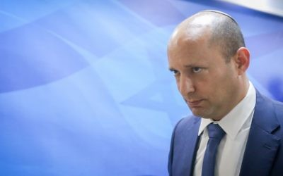 Education Minister Naftali Bennett arrives to the weekly cabinet meeting at the Prime Minister's Office in Jerusalem on June 25, 2017. (Marc Israel Sellem/Pool)