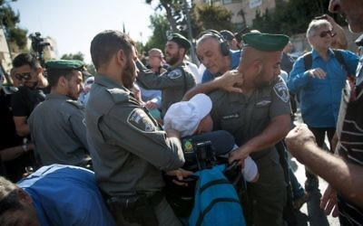Activists clash with police at a protest calling to increase disability stipends outside the Prime Minister's Residence in Jerusalem, June 27, 2017. (Yonatan Sindel/Flash90)